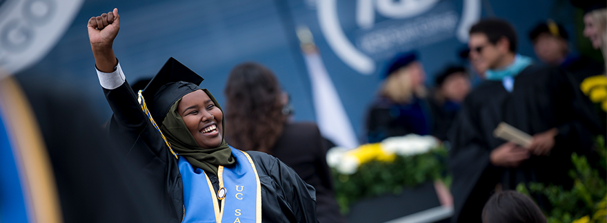 UC San Diego students celebrate in cap and gown at commencement (June 2017)