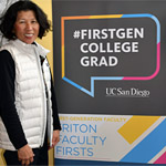 UC San Diego faculty member / lecturer posing near #firstgen sign