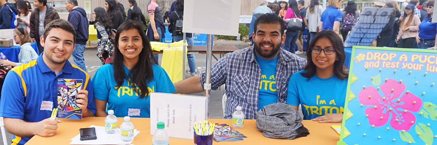 UC San Diego students serve as hosts at an information table