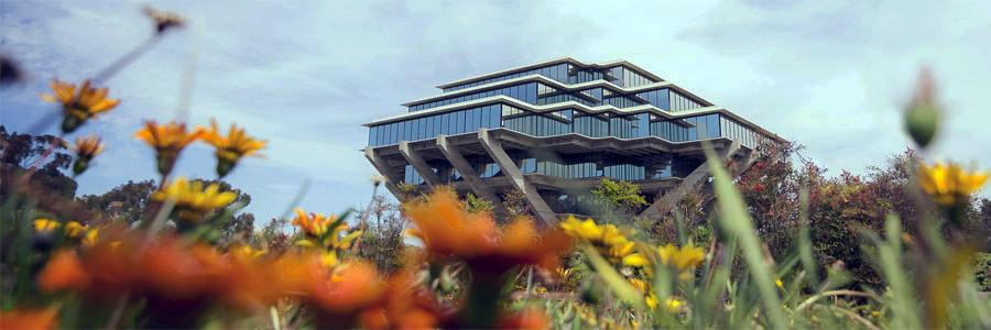 Photo of UC San Diego Geisel Library - with orange flowers in the foreground
